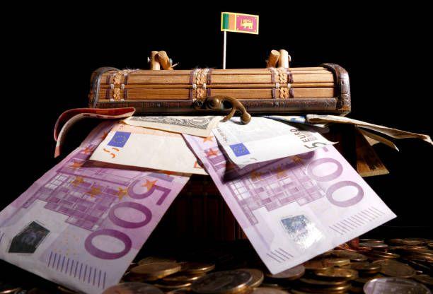sri lankan flag on top of crate full of money