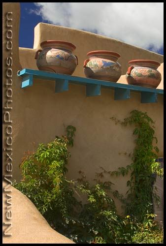 Three large pots overlook one of many courtyards in Taos.