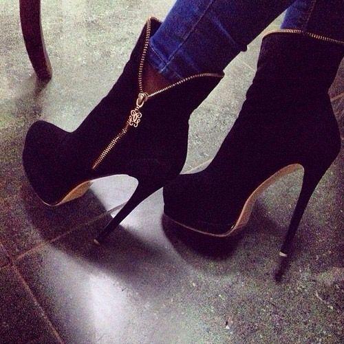 black heel boot with golden zipper