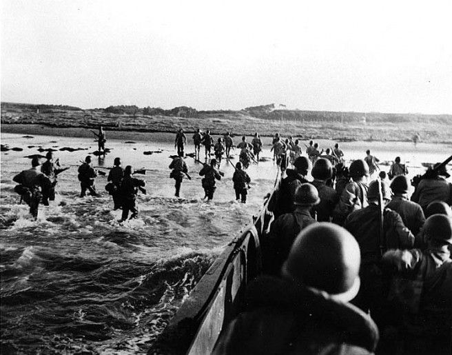 Marines go ashore for initial occupation of Japanese facilities, probably near Yokosuka, circa 30 August 1945. Taken by a USS Iowa (BB-61) photographer. Credit: Naval Historical Center.