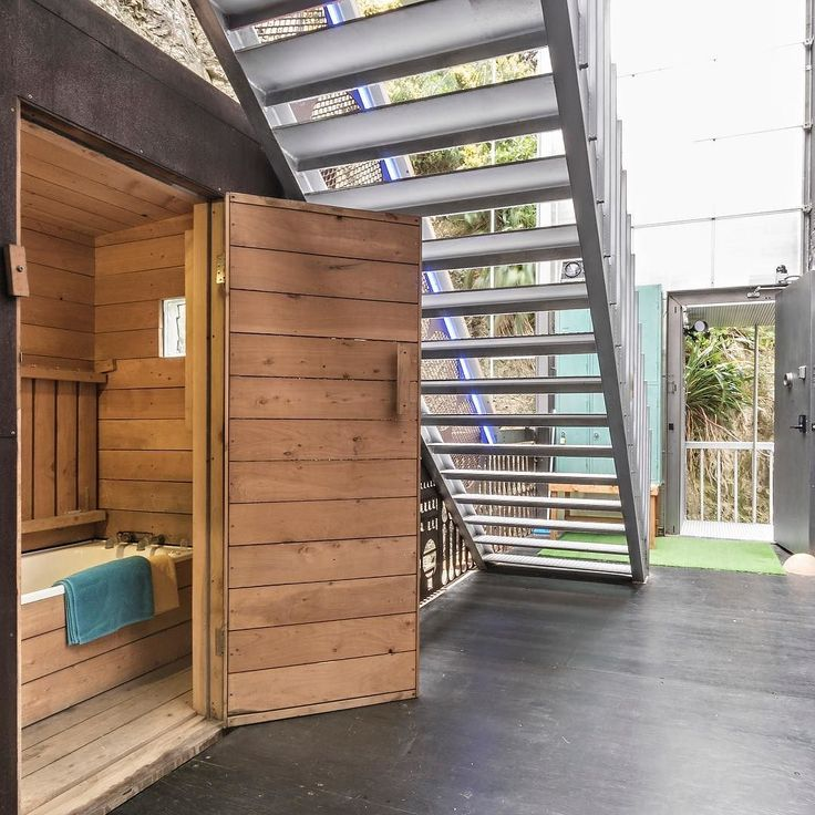 If you feel like a bath there's a separate macrocarpa bathhouse on the lower landing #macrocarpa #bathhouse #uniquenz #uniquehomes #containerhome #containerhouse #industrialdesign #wellingtonnz #owhirobay #wellingtonlivenz #wellywood