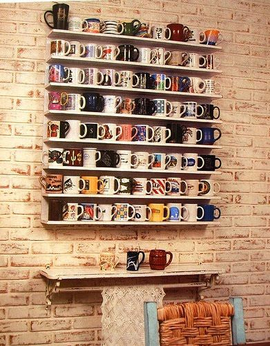 Nice coffee mug wall display on brick.