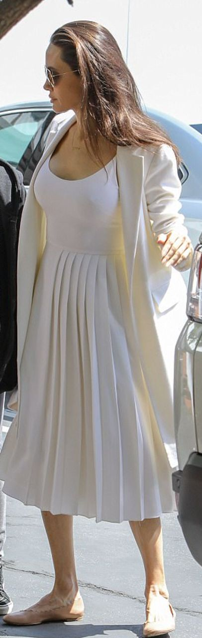 Who made  Angelina Jolie's tan ballet flat shoes and white pleated dress?
