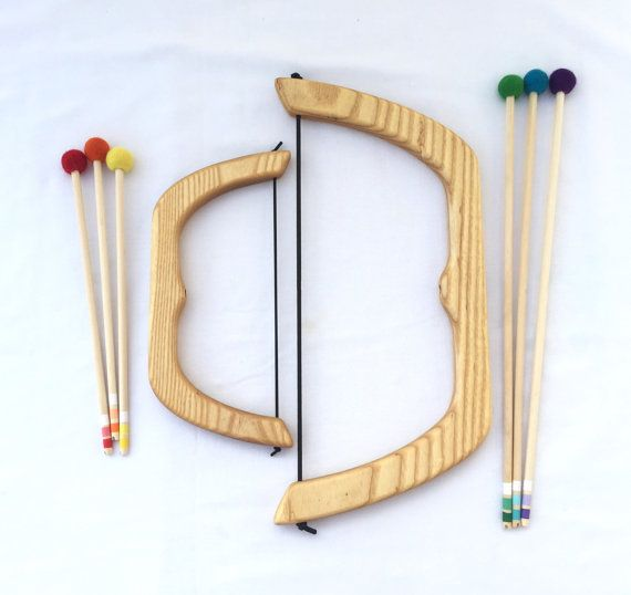 After several requests for a larger version of our most popular toy, here it is--a larger wooden bow and arrows! This one is 18 long and comes with three 18 arrows. It shoots the same distance as our other bow, but offers more grip area for larger hands. It will suit six year olds and up. Made of the same strong hard ash wood and softened with the fun colorful wool felt balls. Colors of arrows will vary from set to set, though you are welcome to request specific colors with your order. The…