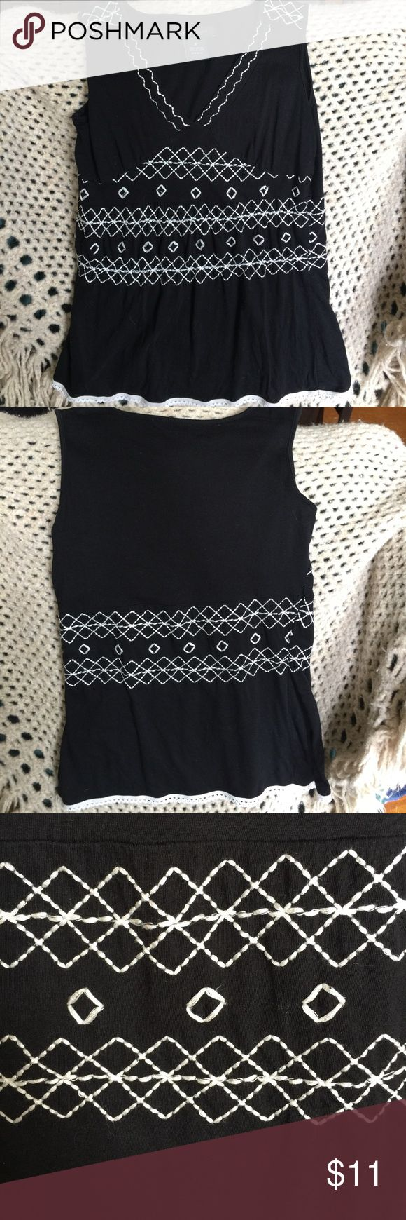 BCBGMaxAzria Top size S BCBGMaxAzria black with white embroidering. Size S. worn only a few times. Plz see pics of embroidering as a few have come loose. Small hole in back near tag. BCBGMaxAzria Tops Tank Tops