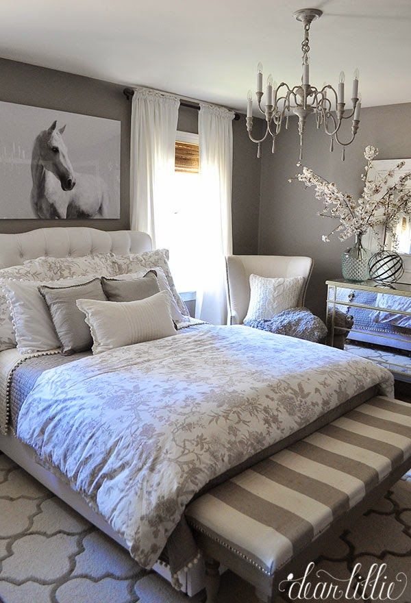 Unexpected artwork like this oversized horse photograph from @homegoods adds a bold touch to this monochromatic gray bedroom. (sponsored pin)