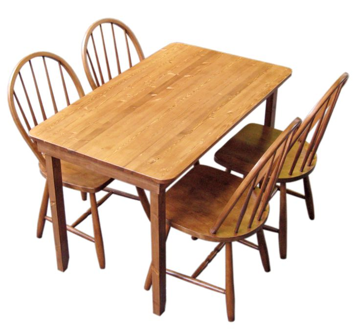 Here's a neat combination of old (refinished chairs) and new (pine table), just right for a cozy breakfast nook