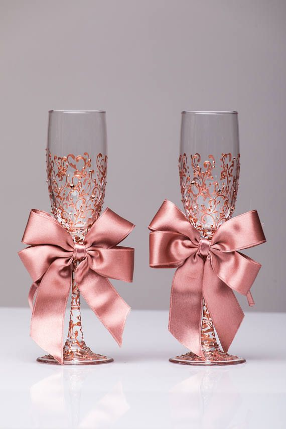 Personalized wedding flutes wedding champagne glasses champagne flutes toasting flutes rose gold champagne flutes wedding flutes Set of2  For these glasses color: rose gold  All completely handmade! MEASUREMENTS: -Champagne flutes : Height - 9.2 inch (23.5 sm). Volume – 170ml (6.1 oz) Custom champagne glasses may be created to fit your needs. Your unique wedding colors can be used for this design. Names and date may be painted to customize to your occasion. Glasses will be carefully packed…
