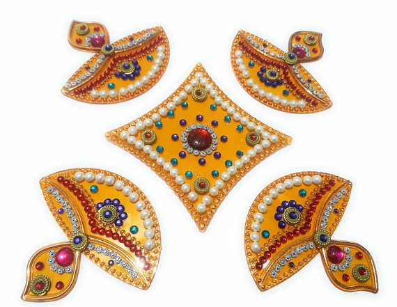 Check out this item in my Etsy shop https://www.etsy.com/uk/listing/557439280/handcrafted-decorative-rangoli-set