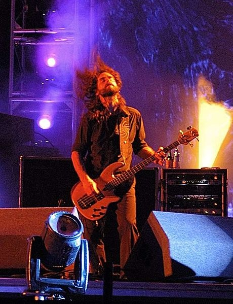 Justin Chancellor of Tool.  Pedal board to die for and odd rhythmic wanderings.