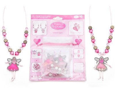 Make your own fairy necklaces Thread heart beads shiny flower beads and sparkly pink beads along with apretty fairy pendant to create your own