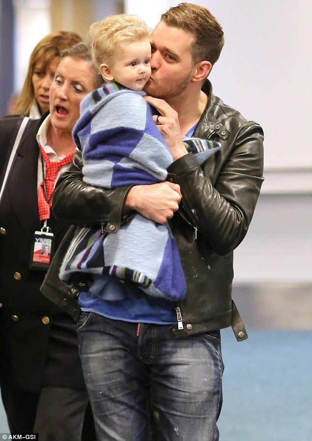 Michael Buble was seen kissing his son Noah as they arrived in Vancouver, British Columbia
