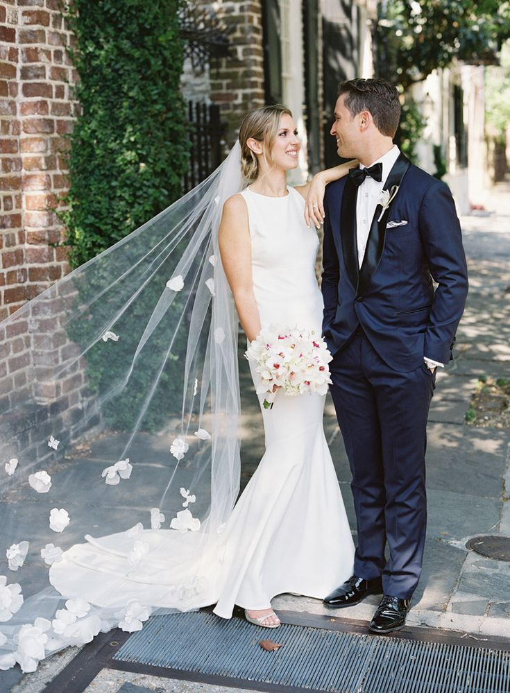 How gorgeous is this unique textured veil with floral appliques!?  (Virgil Bunao)