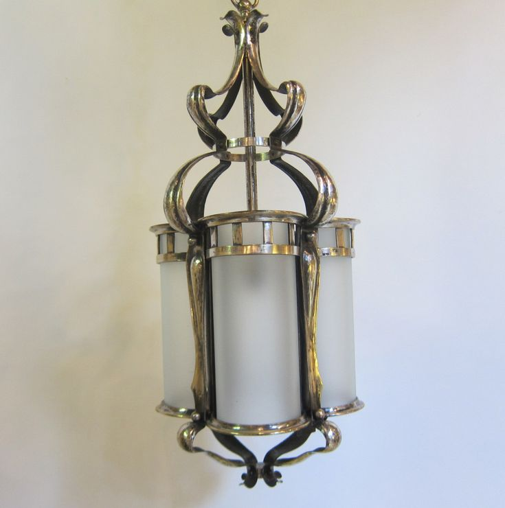 English Arts and Crafts lantern in the original silver plated finish, complete with cylindrical panels in a satin glass finish. www.antiquelightingcompany.com