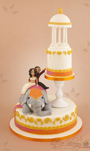 this wouldnt be my actual cake.. but it is so adorable. maybe a rehearsal cake?