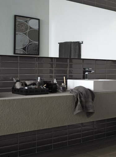 A more masculine tile style in the bathroom oozes sophistication!