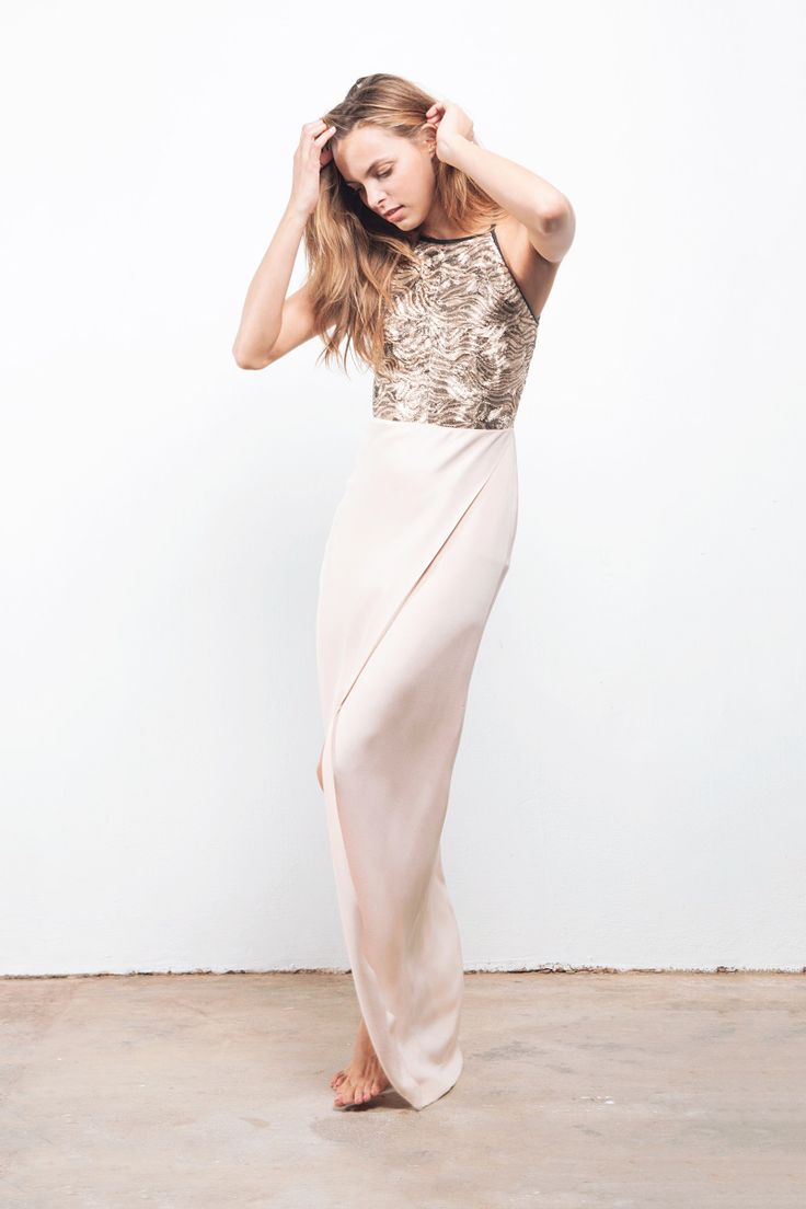 'Wave' gold metallic embroidered organza and nude silk Crepe de Chine floor length dress featuring a halter cut bodice and a overlapping panel in the front.