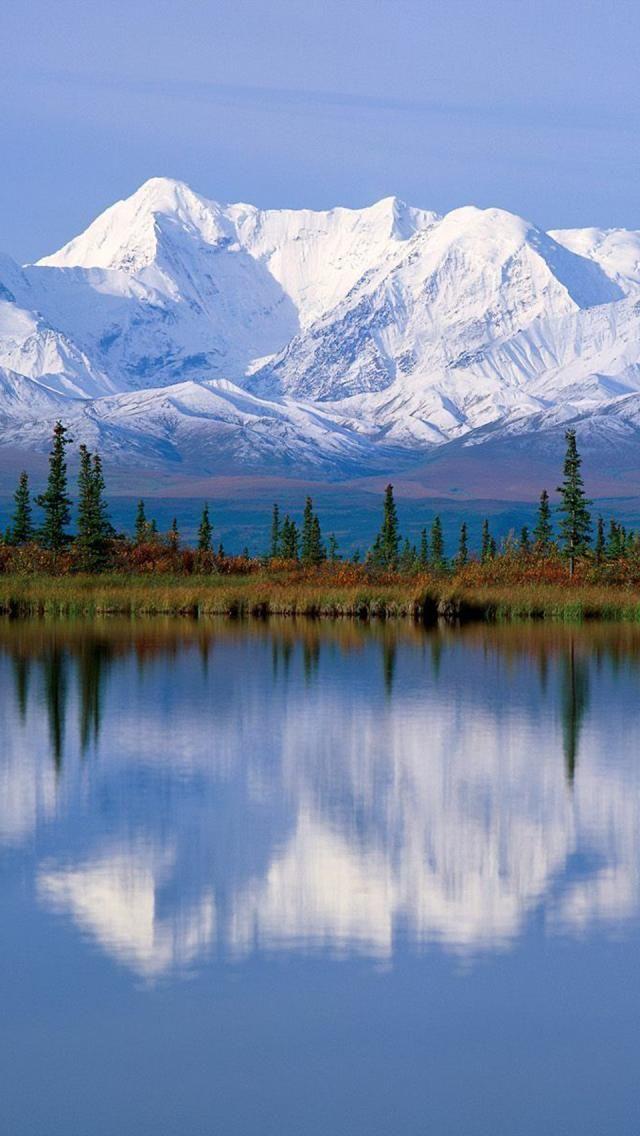 Majestic Mount McKinley massif reflected onto Wonder Lake at Denali National Park in Alaska