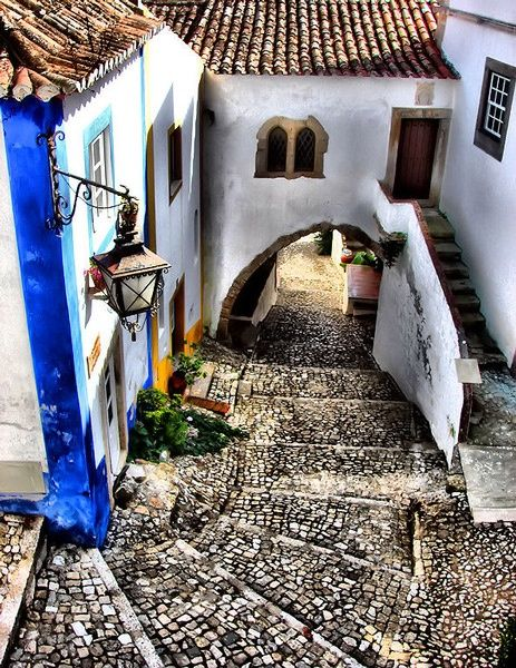 Street at walled small village of Òbidos, Portugal