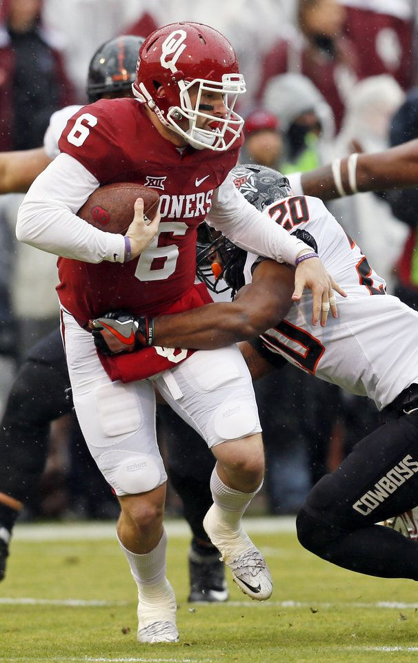 Oklahoma State's Jordan Burton (20) stops Oklahoma's Baker Mayfield (6) in the backfield in the first quarter during the Bedlam college football game between the Oklahoma Sooners (OU) and the Oklahoma State Cowboys (OSU) at Gaylord Family - Oklahoma Memorial Stadium in Norman, Okla., Saturday, Dec. 3, 2016. Photo by Nate Billings, The Oklahoman