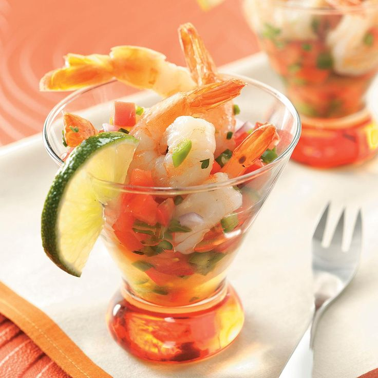Ensenada Shrimp Cocktail Recipe -Tomatoes, peppers, onions and cilantro replace traditional cocktail sauce in this lively Southwestern makeover of the popular appetizer. —Teri Rasey, Cadillac, Michigan