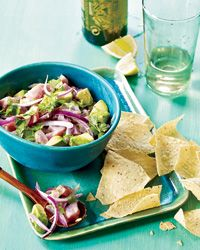 Tuna Ceviche with Avocado and Cilantro.  Pretend the Tortilla chips are just props for food styling the photo.