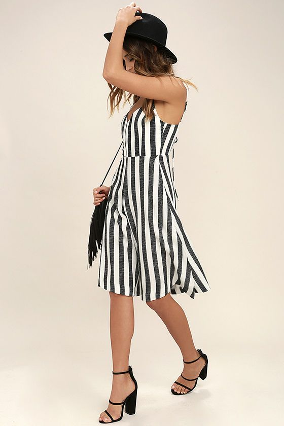 The Even Better Black and White Striped Midi Jumpsuit is more stylish than we could have ever imagined! Gauzy, black and white striped woven fabric, falls from adjustable straps, into a princess-seamed bodice and attached culotte pant legs, with side slits. V-back with tying accent. Hidden side zipper/clasp.