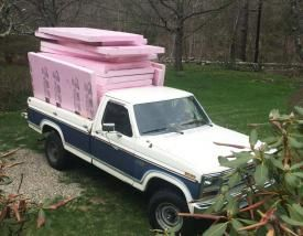 Photo of a pickup truck loaded with recycled XPS insulation