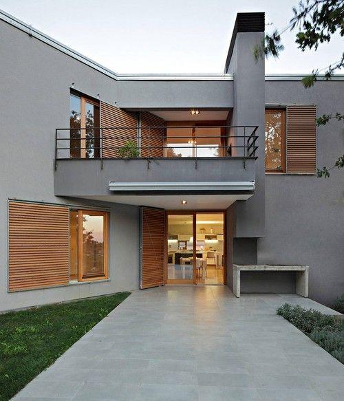 Cedar windows, rendered walls... looks familiar!