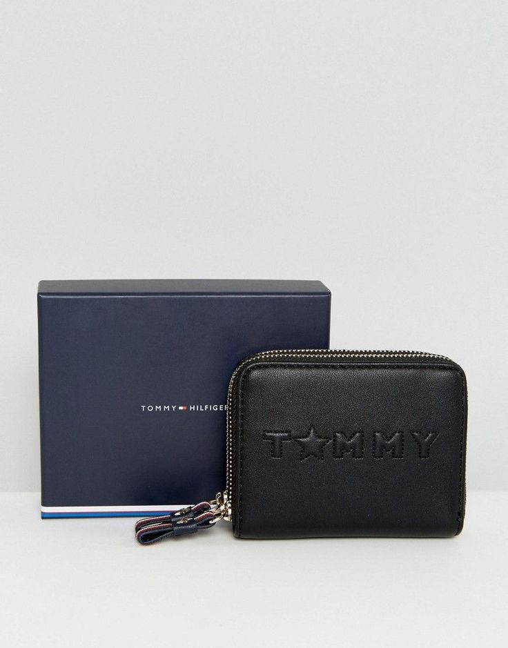 Get this Tommy Hilfiger's purse now! Click for more details. Worldwide shipping. Tommy Hilfiger Medium Logo Zip Around Purse - Black: Purse by Tommy Hilfiger, Faux-leather outer, Zip closure, Tommy Hilfiger logo, Multi card and cash compartments, Wipe with a soft cloth, 100% Polyvinylchloride. Tommy Hilfiger is a global brand with a classic/cool American heritage. Think timeless, preppy Americana, updated, re-imagined and always changing across a collection of jersey staples, denim and…