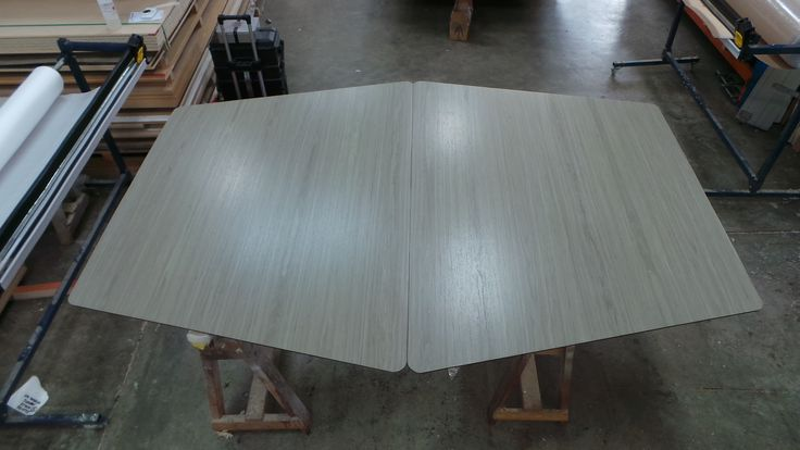 Trapezium Metalwood Tables - Timber veneer wrapped onto steel.