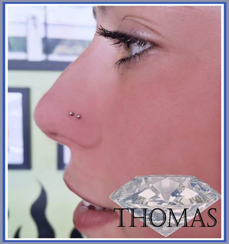 double nose piercing with steel studs :)