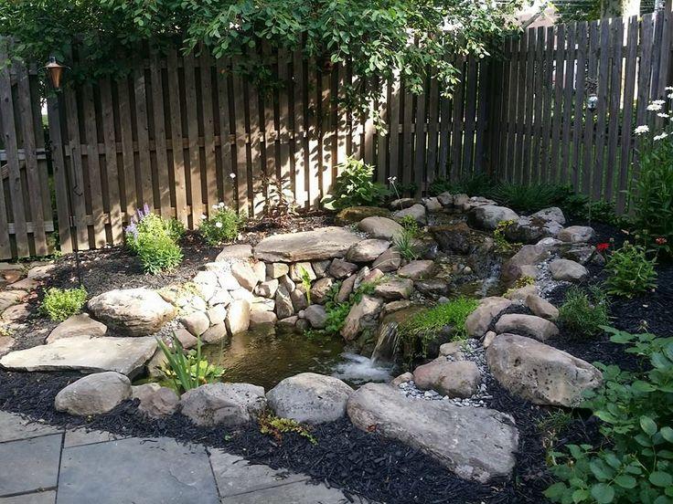 Beautiful backyard pond with surrounding landscaping. #backyard #pond #waterfall #landscape #garden