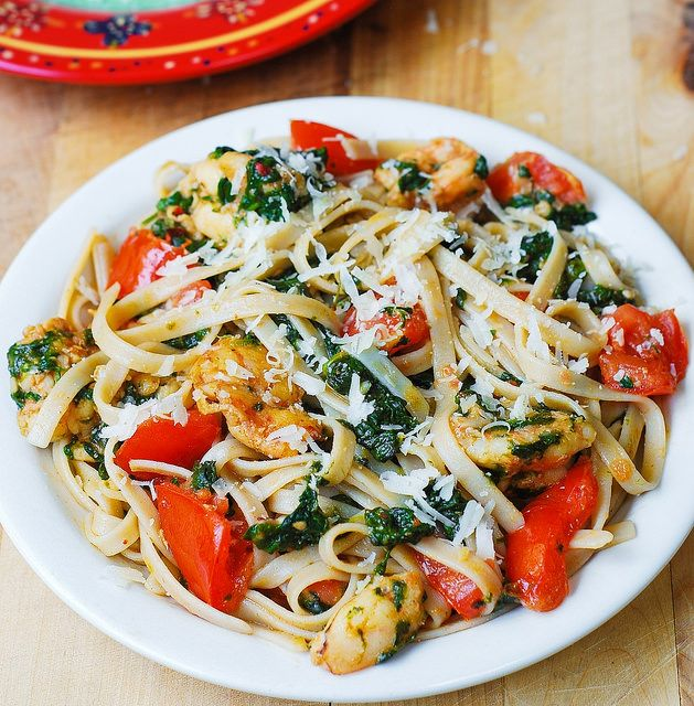 Shrimp, tomato, and spinach pasta in garlic butter sauce  http://juliasalbum.com/2014/10/shrimp-tomato-and-spinach-pasta-in-garlic-butter-sauce/