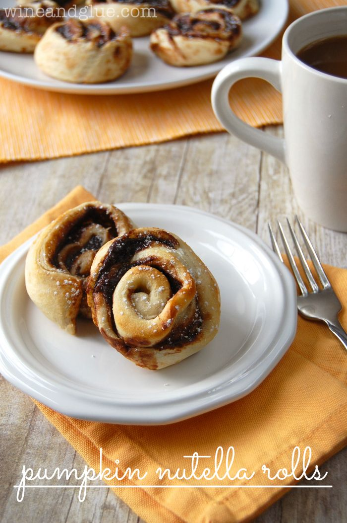 Pumpkin Nutella Rolls!  The delicious flavors of pumpkin and Nutella swirled together in a delicious pinwheel.  Super simple to make and inc...