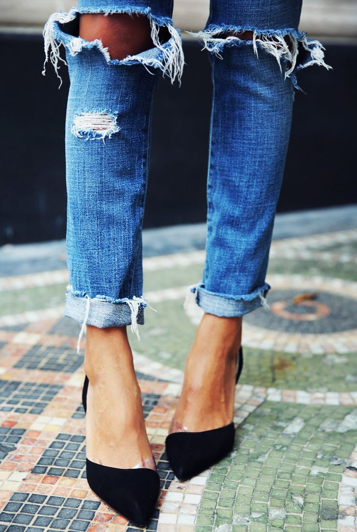 Distressed skinny jeans and black pointy pumps