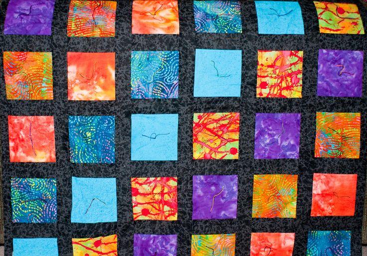 Colorful batik and black quilt