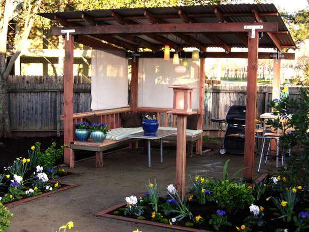 this could be a really cool idea for part of our back porch, i love rain on a tin roof, and my soon to be hubby loves some good ol' shade (DIY Network)