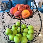 Fruit basket made from a broken garage door spring and a couple of old messed-up drill bits.