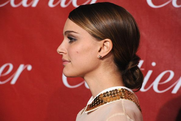 Natalie Portman Chignon  Natalie never ceases to amaze us on the red carpet. The actress rocked a sleek chignon at the International Film Festival.