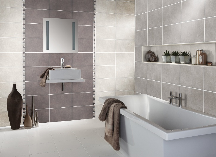 using a feature wall of tiles in a different colour is a great way to add small bathroom