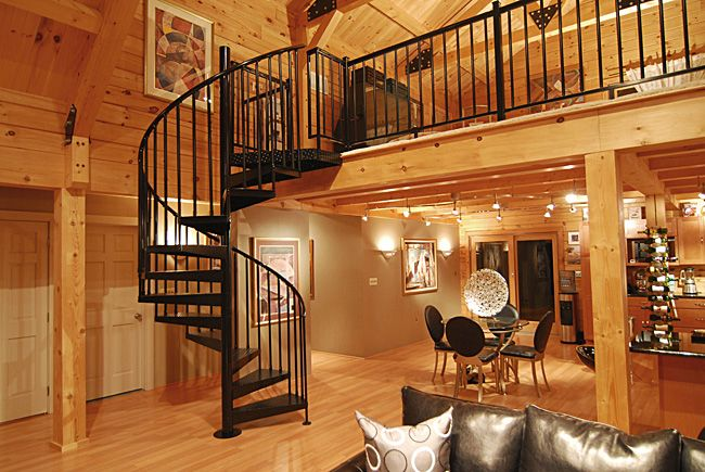 interior spiral stair in a log timber frame home