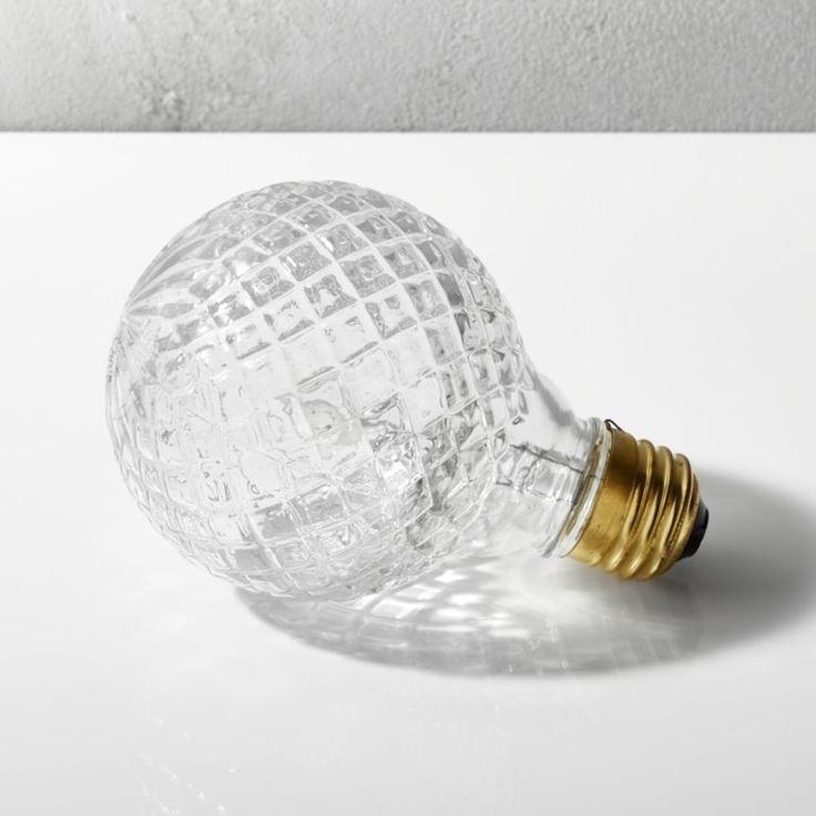 Shop cut glass halogen 40W light bulb.   Victorian-style cut glass illuminates eclectic contrast in modern fixtures.  We like this diamond-patterned halogen bulb paired with our retro utility pendant or sleek ohm marble table lamp.