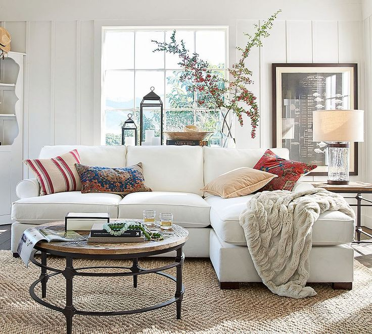 Townsend Upholstered Roll Arm Sofa with Reversible Storage Chaise Sectional, branches and lanterns behind sofa
