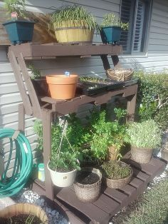 our herb garden pallet craft my wife always has great re use ideas, gardening, pallet projects, Pallet reuse herb garden