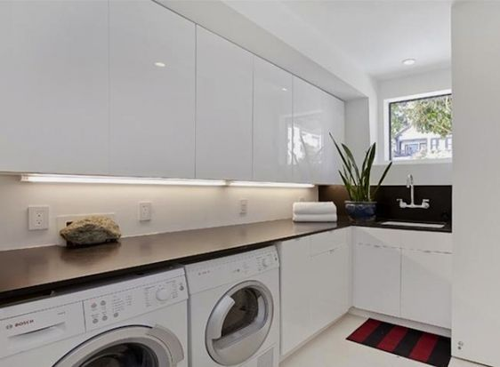 neat laundry with ample countertop space
