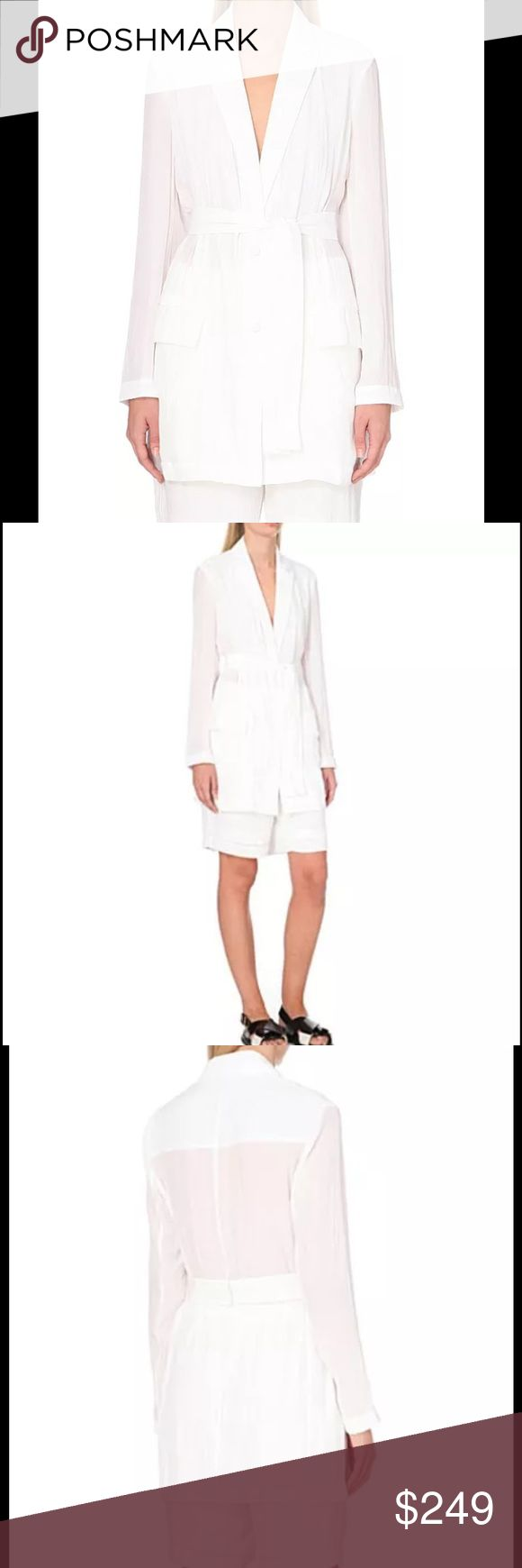 THEORY White Influx Glider Longline Blazer Jacket NWT $395 THEORY White Influx Glider Longline Blazer Jacket Sz S  A relaxed take on a typically assertive style, the Influx jacket from contemporary New York label, Theory is designed to a streamlined silhouette. A diaphanous, featherweight fabrication, the laid-back yet sophisticated form will layer office looks or complete dinner dressing with ease. Theory longline jacket. Exposed poppers at front. V-neck, long sleeves, two patch pockets…