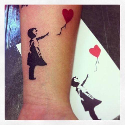 Banksys ballon girl tattoo on the right forearm. Tattoo...
