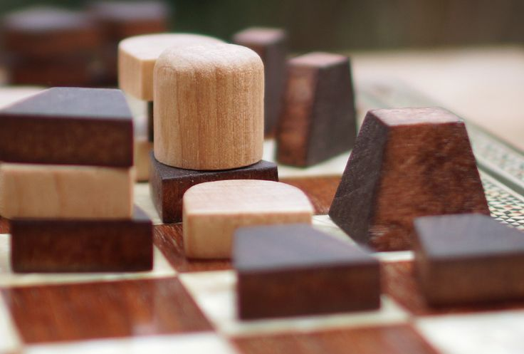 It's 5:30, the light is fading, and I'm in my back yard playing Tak. I wanted a nice photo, and so I wanted natural light and a neutral background, rather than the chaos in the house.But of course I wanted all the pieces to be in a sensible place. So I tried to set up the board the way I always do: by playing a game. The first game was a disaster. It was ugly in both senses. I play terribly against myself. And the pieces wound up in completely the wrong place. The second game wasn't much…