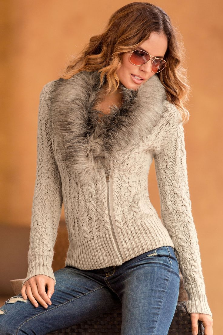 We're obsessed with this cable knit sweater, with its luxurious, removable faux-fur collar. Hit the slopes in this versatile cardigan or simply wear around town with straight-leg denim and boots.